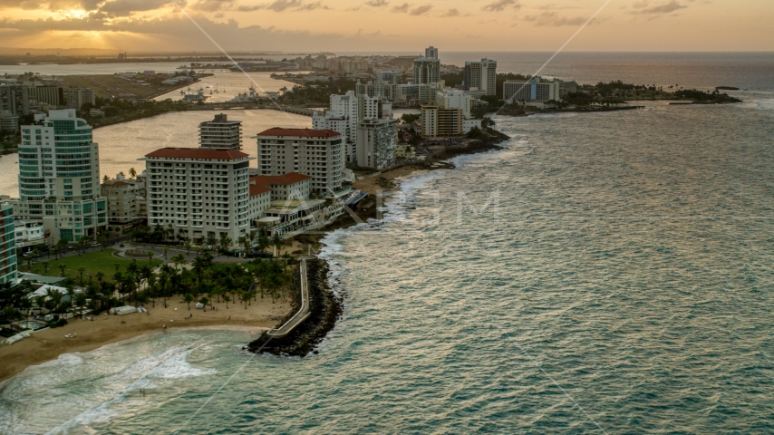 Beachfront Caribbean hotels along the ocean, San Juan, Puerto Rico, sunset Aerial Stock Photos | AX104_070.0000000F