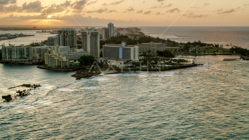 The oceanfront Caribe Hilton Hotel and Normandie Hotel, San Juan, Puerto Rico, sunset Aerial Stock Photos | AX104_072.0000000F