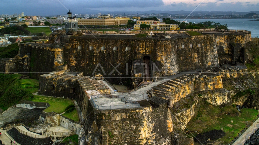A view of Fort San Felipe del Morro, Old San Juan, Puerto Rico, twilight Aerial Stock Photos | AX104_083.0000000F