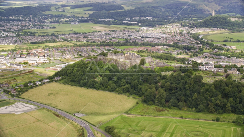 Hilltop Stirling Castle by residential neighborhoods, Stirling, Scotland Aerial Stock Photos | AX109_016.0000000F