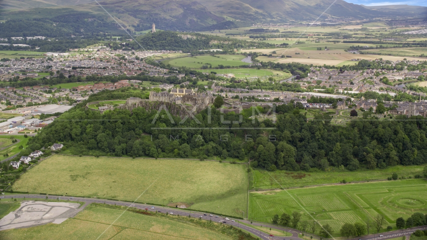 Stirling Castle and residential area in Scotland Aerial Stock Photos | AX109_017.0000000F