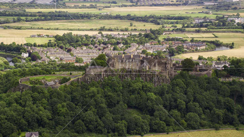 Hilltop Stirling Castle among trees, Scotland Aerial Stock Photos | AX109_019.0000000F