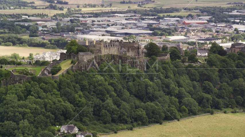 A view of historic Stirling Castle on a hill in Scotland Aerial Stock Photos | AX109_021.0000170F