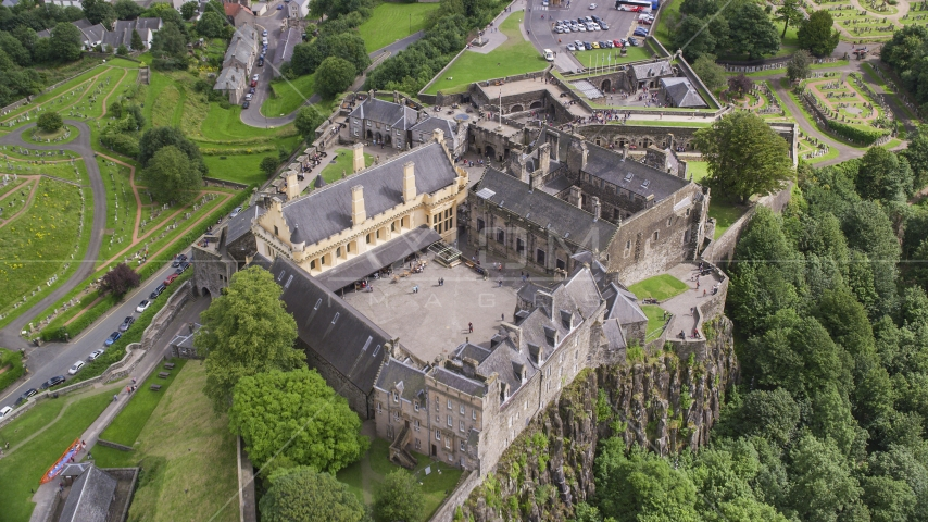A view of the grounds of iconic Stirling Castle, Scotland Aerial Stock Photo AX109_025.0000198F | Axiom Images