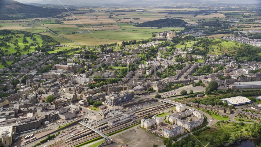 Historic Stirling Castle seen from apartment buildings, Scotland Aerial Stock Photos | AX109_028.0000013F