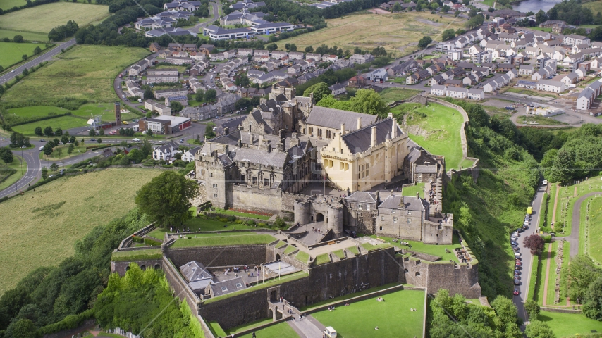 Historic Stirling Castle on a hill in Scotland Aerial Stock Photos | AX109_035.0000118F