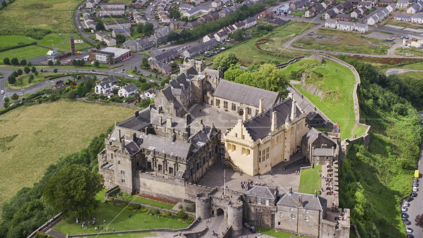 Iconic Stirling Castle and grounds on a hill, Scotland Aerial Stock Photos | AX109_036.0000000F