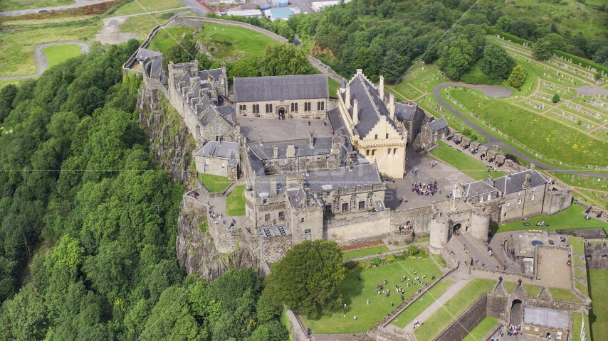 Historic Stirling Castle with tourists, Scotland Aerial Stock Photo AX109_040.0000000F | Axiom Images
