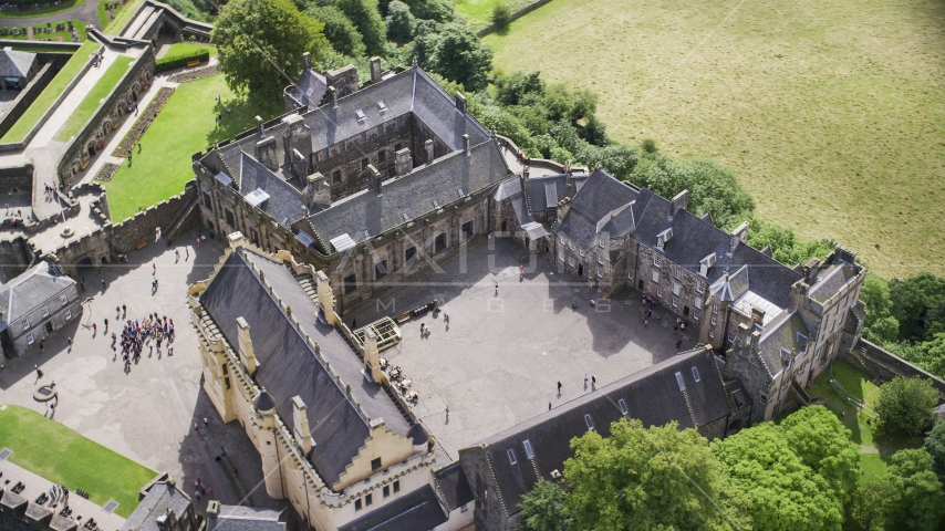 The historic Stirling Castle and grounds with tourists, Scotland Aerial Stock Photos | AX109_042.0000106F