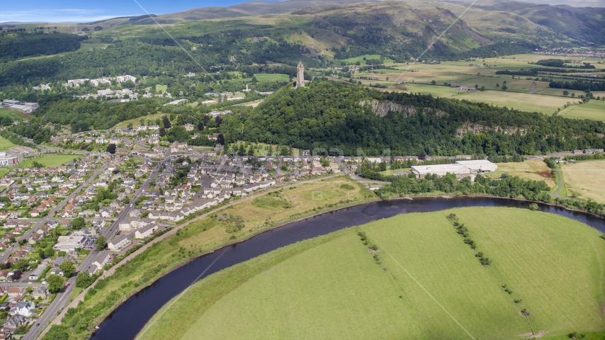 A view of the iconic Wallace Monument surrounded by trees, Stirling, Scotland Aerial Stock Photos | AX109_046.0000000F