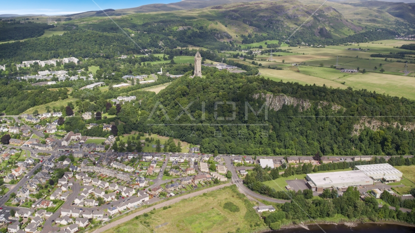 The historic Wallace Monument on a hill with trees, Stirling, Scotland Aerial Stock Photos | AX109_047.0000064F