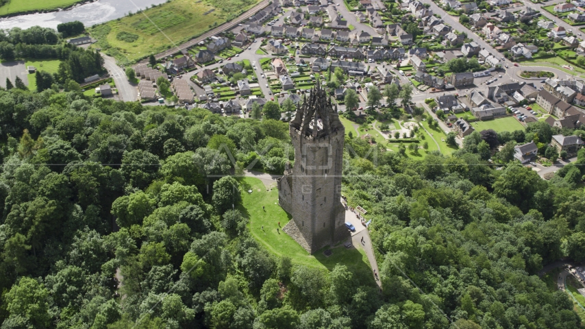The historic Wallace Monument with a view of Stirling, Scotland Aerial Stock Photos | AX109_051.0000142F