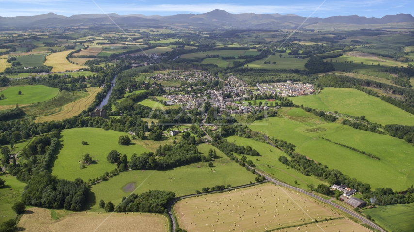 A rural village beside green farmland, Duone, Scotland Aerial Stock Photos | AX109_065.0000000F