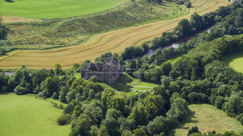 Historic Doune Castle and trees in Scotland Aerial Stock Photos | AX109_066.0000000F