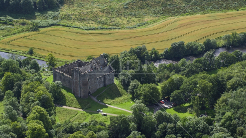 A view of Doune Castle with trees, Scotland Aerial Stock Photos | AX109_067.0000000F