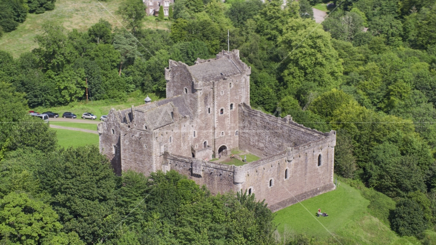 Doune Castle with tourists on the grounds, Scotland Aerial Stock Photos | AX109_071.0000000F