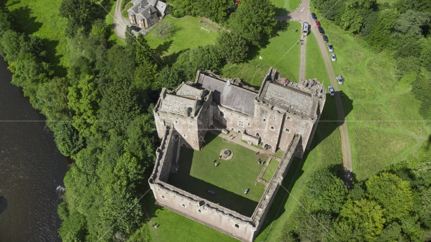 A bird's eye view of historic Doune Castle and its grounds, Scotland Aerial Stock Photo AX109_072.0000120F | Axiom Images