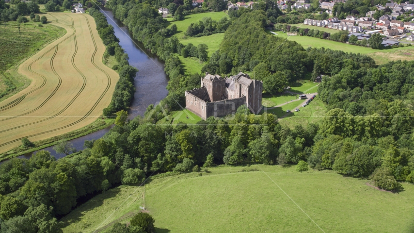 Doune Castle and River Teith among trees, Scotland Aerial Stock Photos | AX109_075.0000000F