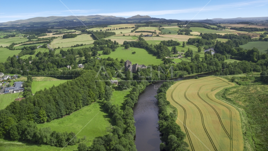 River Teith and historic Doune Castle near farmland, Scotland Aerial Stock Photos | AX109_087.0000000F
