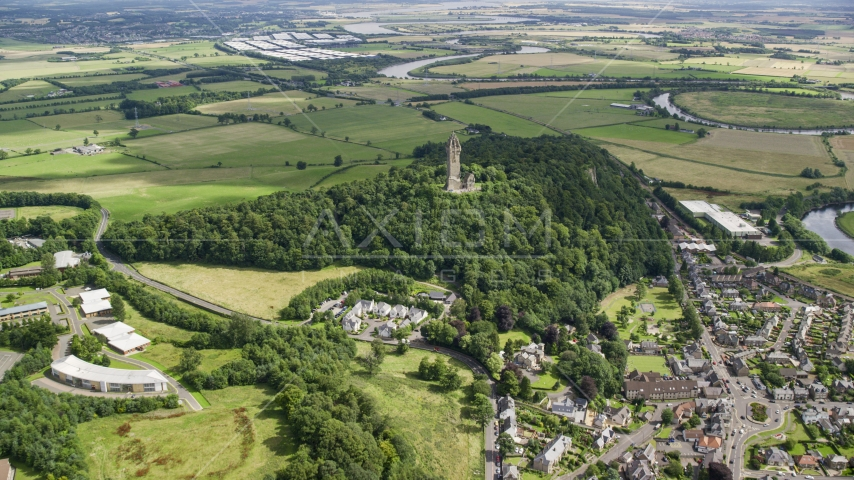 Historic Wallace Monument atop Abbey Craig hill, Stirling, Scotland Aerial Stock Photos | AX109_099.0000000F