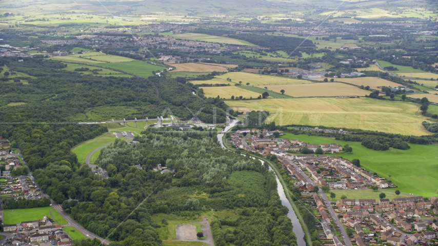 The Falkirk Wheel boat lift by Union Canal and Scottish countryside, Scotland Aerial Stock Photos | AX109_159.0000121F