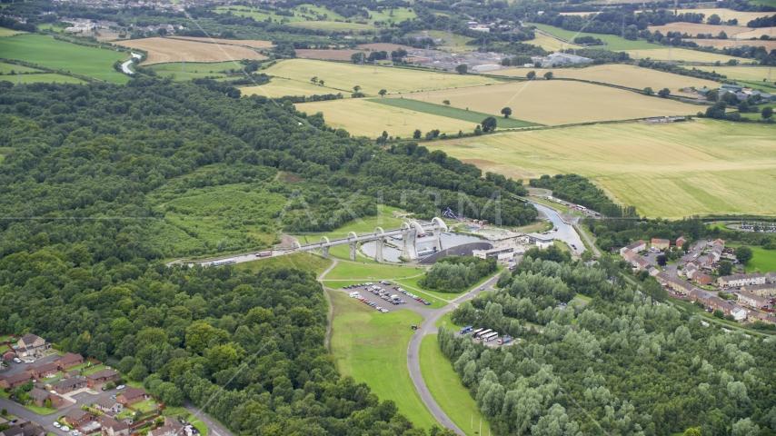 The iconic Falkirk Wheel boat lift near trees and farmland, Scotland Aerial Stock Photos | AX109_161.0000000F
