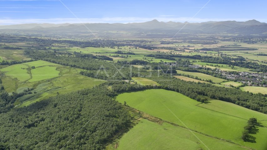 Forests and farm fields, Kippen, Scotland Aerial Stock Photos | AX110_030.0000000F