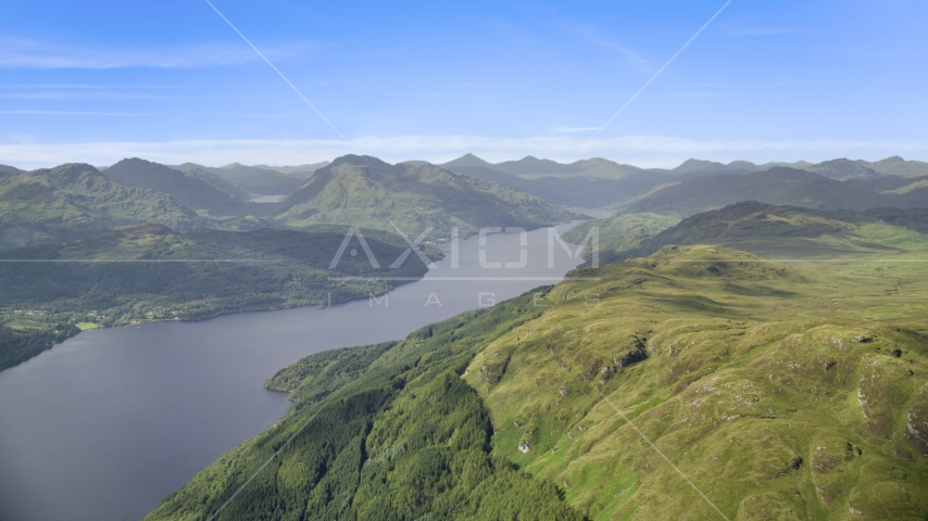 Loch Lomond and green mountains in the Scottish Highlands, Scotland Aerial Stock Photos | AX110_058.0000000F