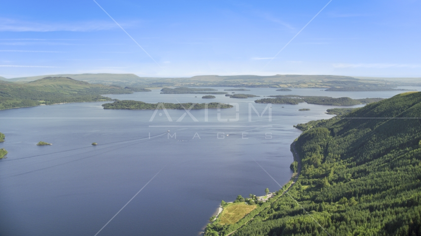 The blue waters of Loch Lomond and tiny islands, Scottish Highlands, Scotland Aerial Stock Photos | AX110_104.0000000F