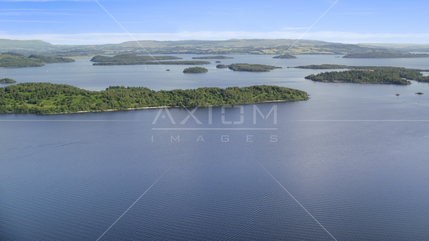 Tree-covered islands in Loch Lomond, Scottish Highlands, Scotland Aerial Stock Photos | AX110_106.0000000F