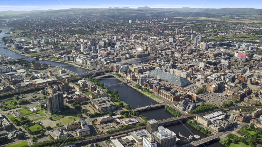River Clyde with bridges by city buildings in Glasgow, Scotland Aerial Stock Photos | AX110_167.0000000F