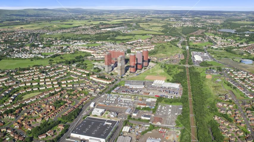 Tall apartment buildings near houses, Glasgow, Scotland Aerial Stock Photo AX110_215.0000046F | Axiom Images