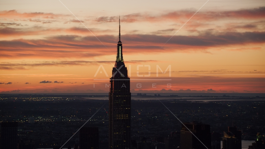 Empire State Building at sunrise in Midtown Manhattan, New York City Aerial Stock Photos | AX118_007.0000000F
