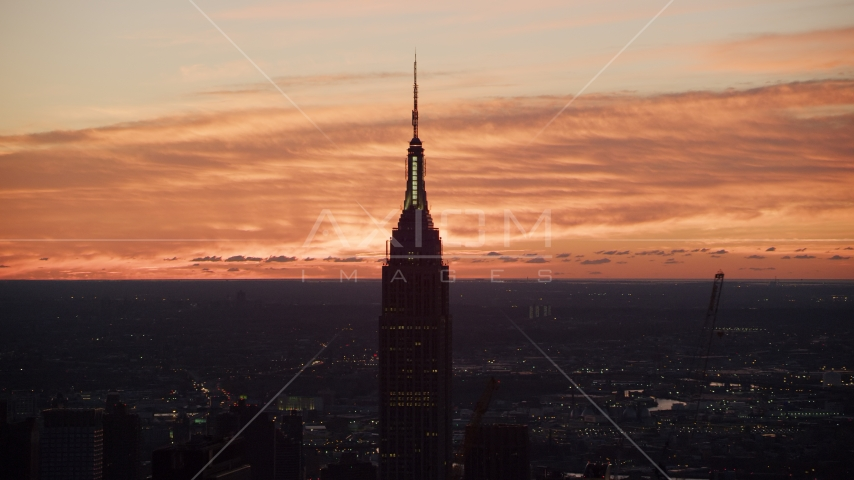 The Empire State Building at sunrise, Midtown Manhattan, New York City Aerial Stock Photos | AX118_009.0000097F