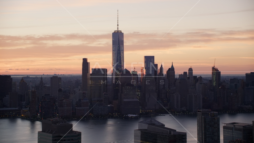 World Trade Center skyline across Hudson River at sunrise in Lower Manhattan, New York City Aerial Stock Photo AX118_030.0000060F | Axiom Images