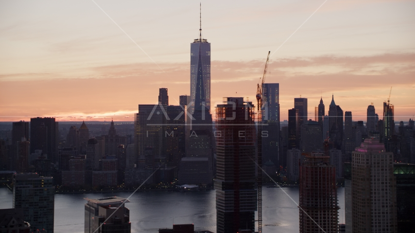 World Trade Center skyline at sunrise in Lower Manhattan, New York City, seen from Jersey City Aerial Stock Photos | AX118_032.0000166F