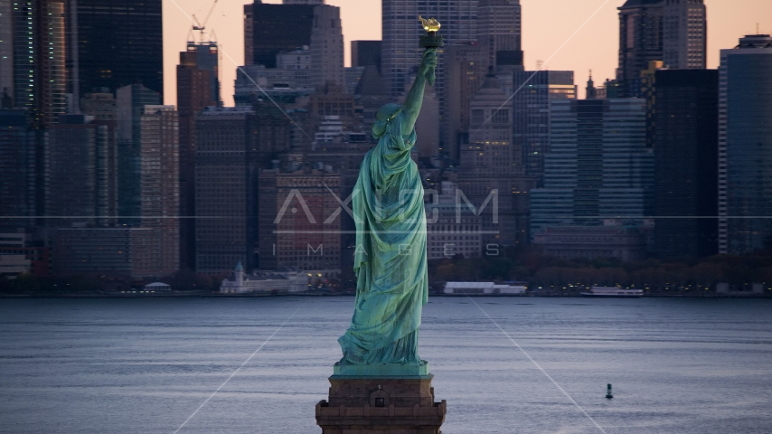 Statue of Liberty and Lower Manhattan skyscrapers at sunrise, New York Aerial Stock Photos | AX118_045.0000075F