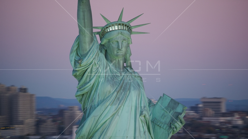 The Statue of Liberty at sunrise, New York Aerial Stock Photos | AX118_059.0000012F