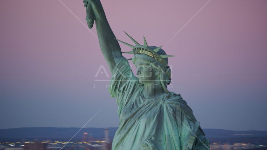 Profile of the Statue of Liberty at sunrise, New York Aerial Stock Photos | AX118_060.0000000F