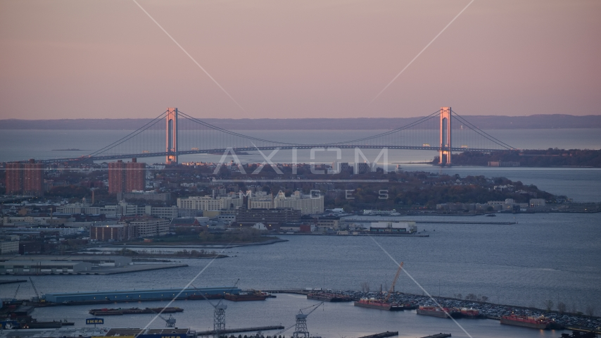 Verrazano-Narrows Bridge and waterfront apartment buildings at sunrise, New York City Aerial Stock Photos | AX118_061.0000092F