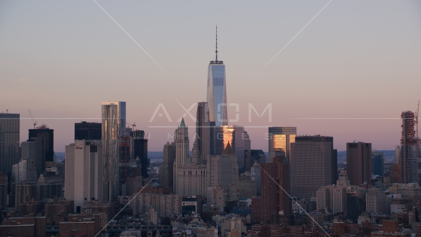 Freedom Tower and skyscrapers at sunrise in Lower Manhattan, New York City Aerial Stock Photos | AX118_070.0000078F