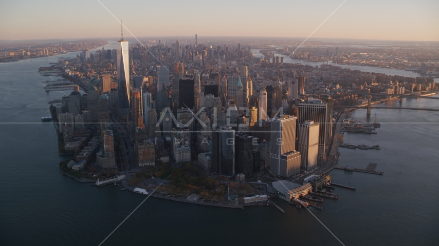 Battery Park and Lower Manhattan skyscrapers at sunrise, New York City Aerial Stock Photos | AX118_086.0000165F