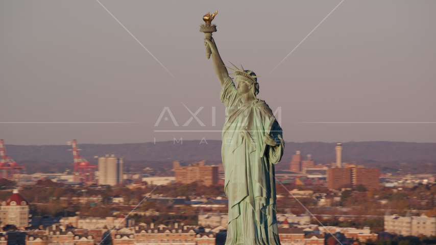 The front side of the Statue of Liberty at sunrise in New York Aerial Stock Photos | AX118_104.0000067F