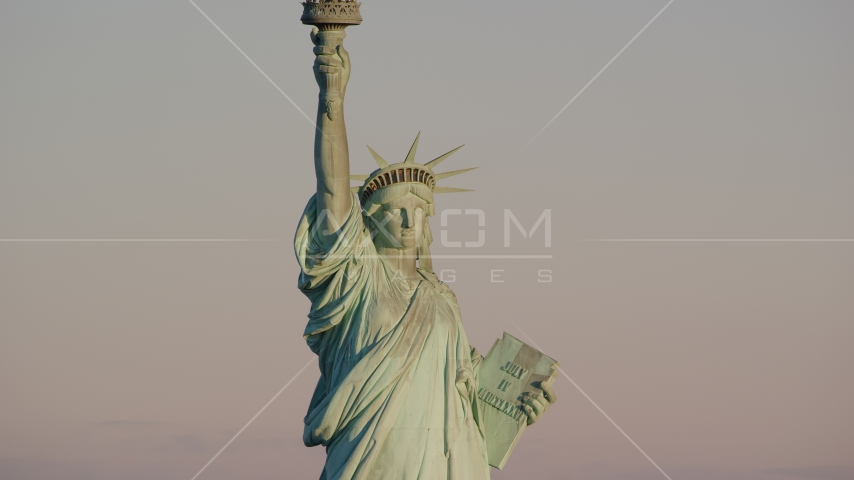 The front of the Statue of Liberty at sunrise in New York Aerial Stock Photos | AX118_107.0000082F
