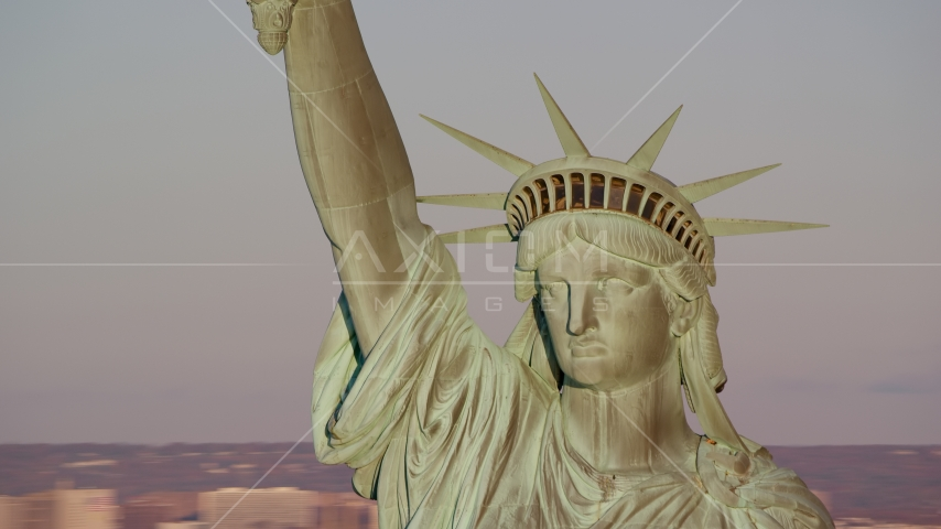 Close-up of the Statue of Liberty at sunrise in New York Aerial Stock Photos AX118_116.0000128F