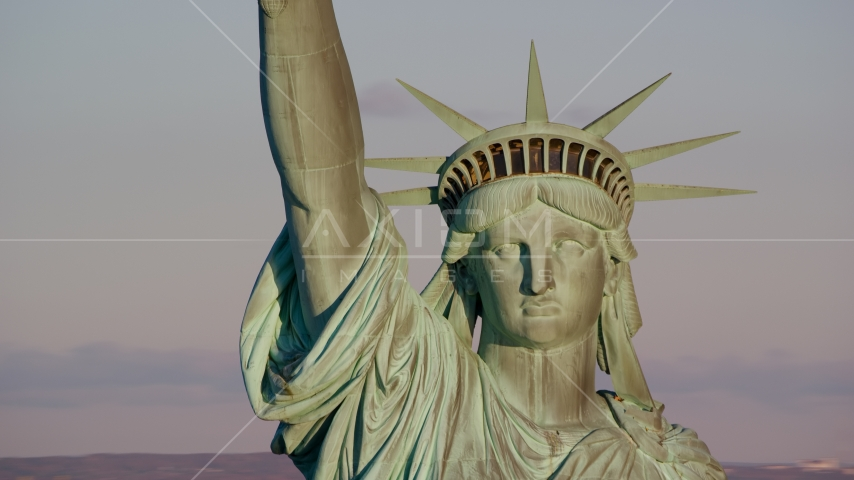 A close-up of the Statue of Liberty at sunrise in New York Aerial Stock Photos | AX118_116.0000231F
