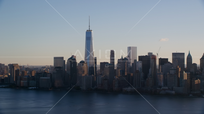 The Lower Manhattan skyline across the Hudson River at sunrise in New York City Aerial Stock Photo AX118_150.0000000F | Axiom Images