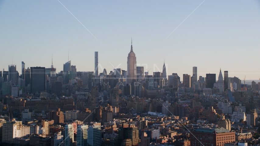 The Empire State Buildings and Midtown skyscrapers at sunrise in New York City Aerial Stock Photos | AX118_157.0000074F