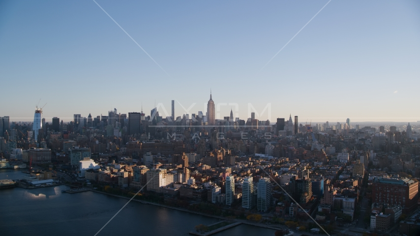 Midtown Manhattan seen from Chelsea at sunrise in New York City Aerial Stock Photos | AX118_158.0000100F