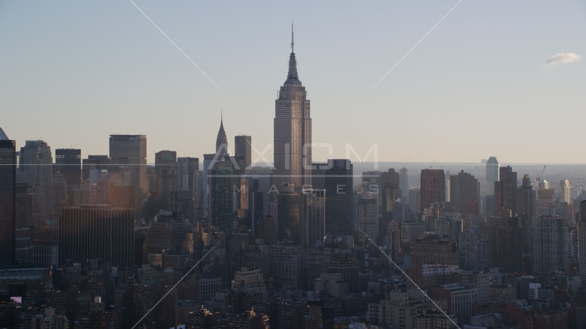 Empire State Building at sunrise in New York City Aerial Stock Photos | AX118_162.0000089F